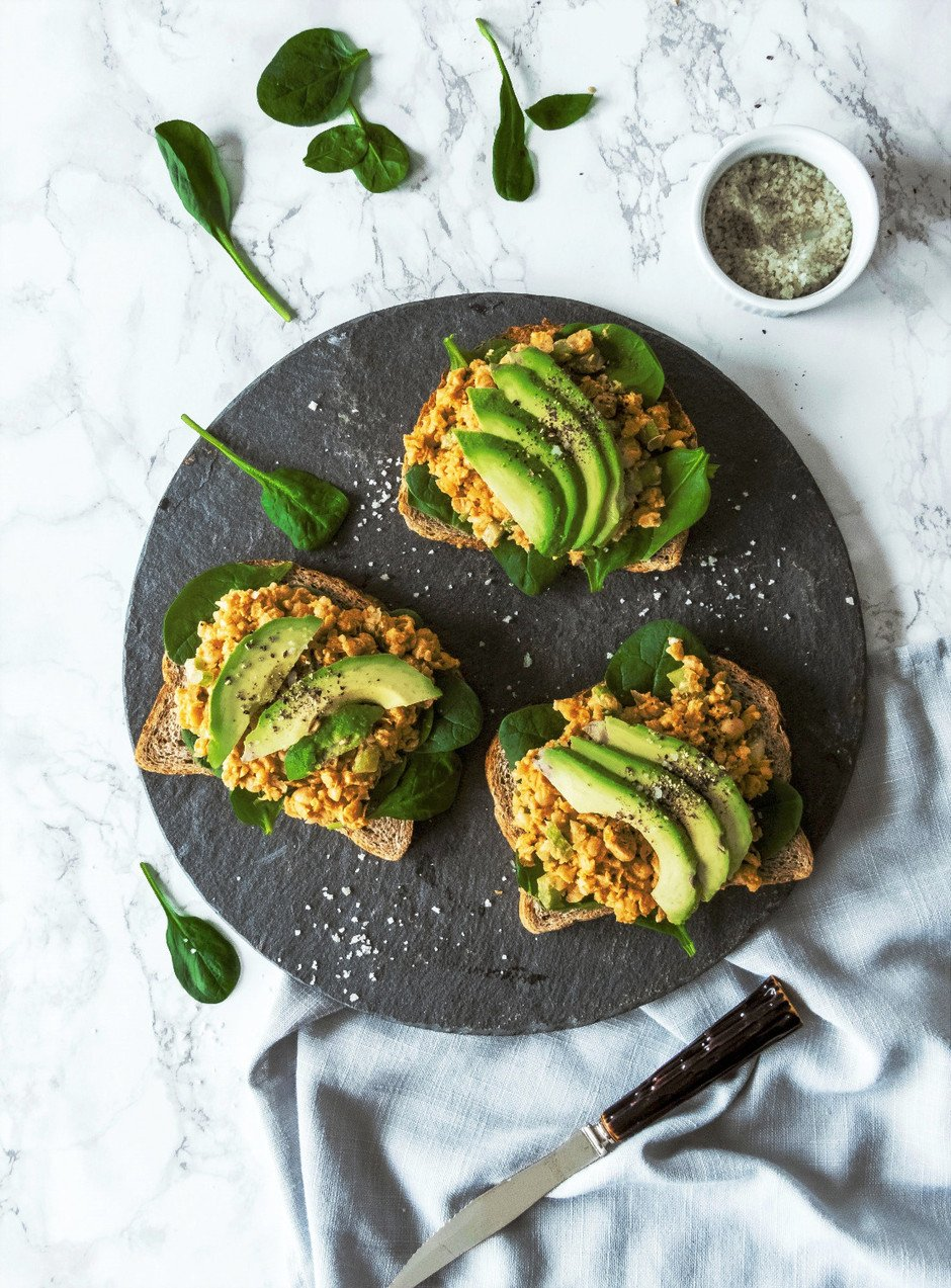 overhead image of chickpea tuna sandwhiches on white background.