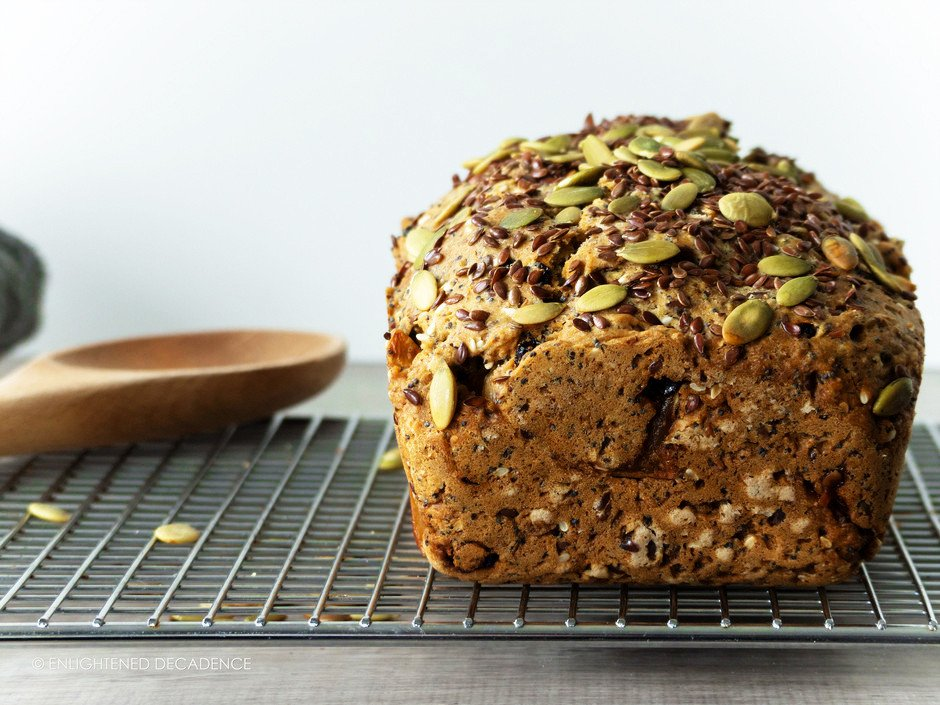a head on image of a loaf of harvest apple crunch quickbread on a cooling rack.