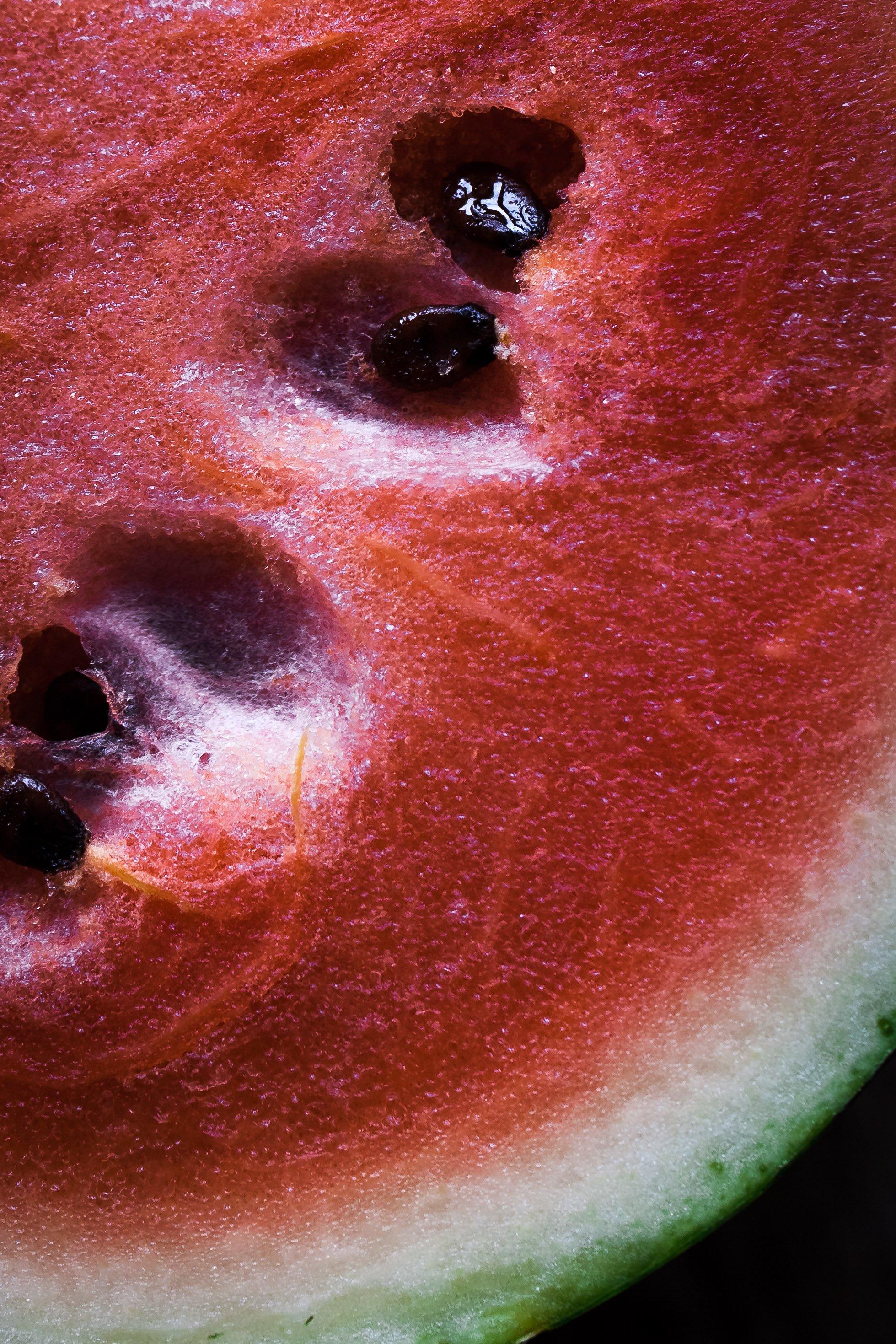 overhead closeup view of a watermelon slice.