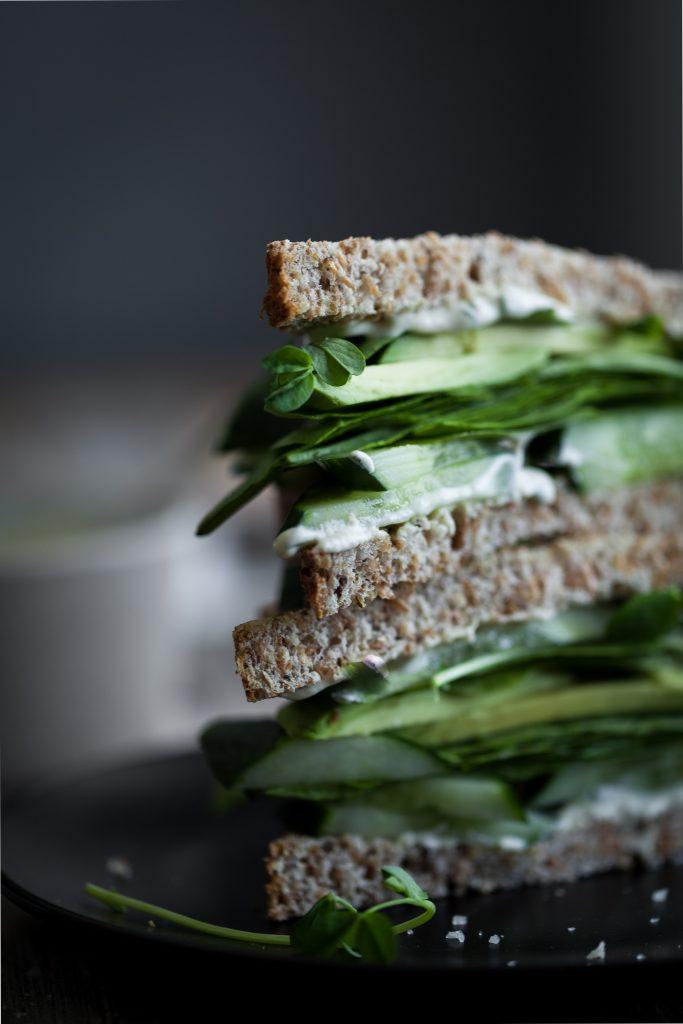 closeup portrait view of the green goddess sandwich layers.