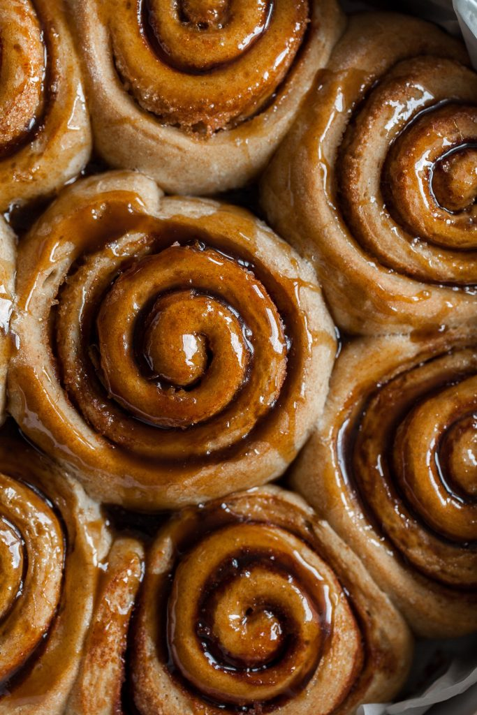 a closeup overhead shot of vegan cinnamon rolls.