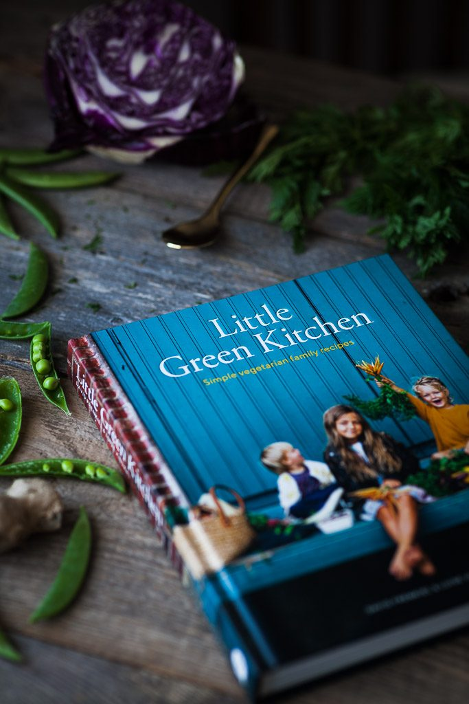 "A ¾ angle image of the cookbook ""Little Green Kitchen"""