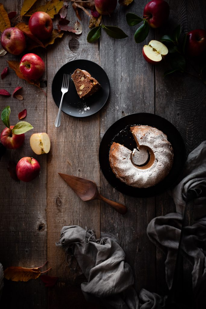 overhead image of vegan apple spice cake with slice removed.