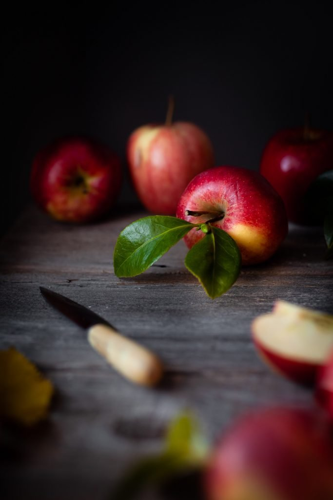 close up of apples and a paring knife.