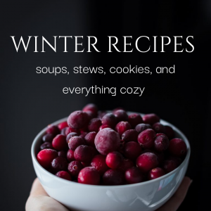 "A bowl of cranberries with the words ""Winter Recipes-soups, stews, cookies, and everything cozy""."