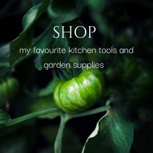 "A green tomato on the vine with the words ""shop my favourite kitchen tools and garden supplies."