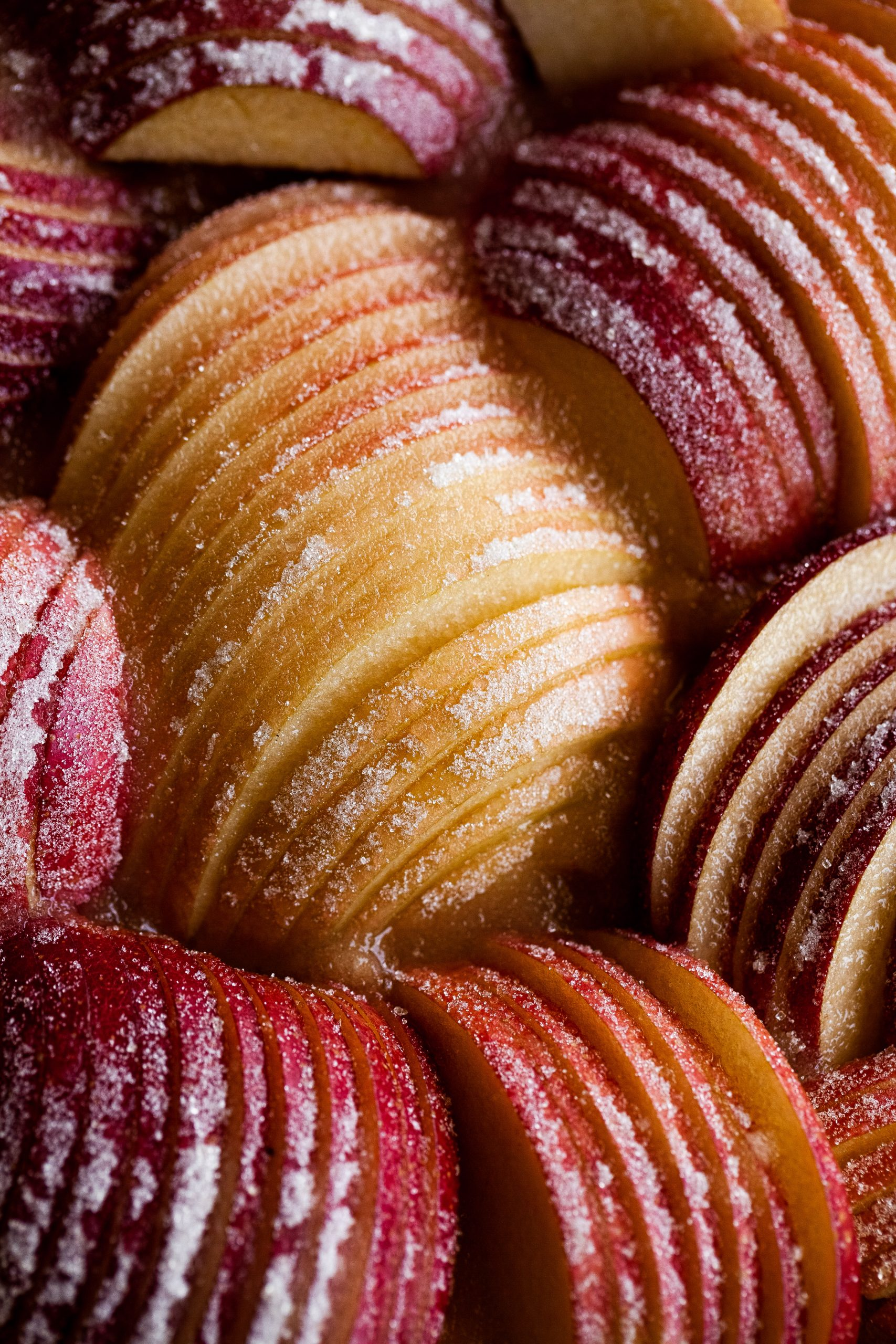 overhead close up of apple slices coated in sugar.