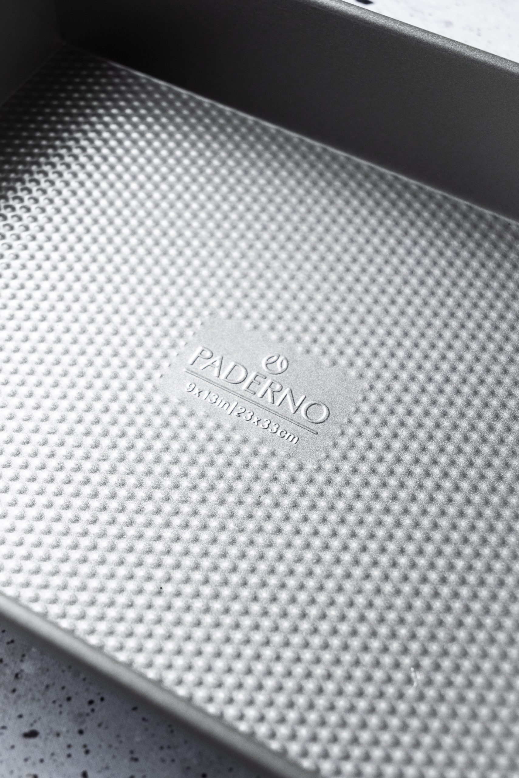 An over head image of an empty baking pan with the text PADERNO.